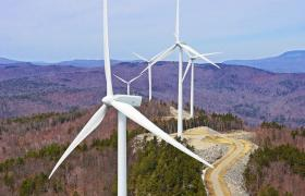 Wind-energy projects like the Groton Wind Farm in New Hampshire require huge amounts of land -- and rural communities are not all happy about it.  Credit: AerialPhotoNH
