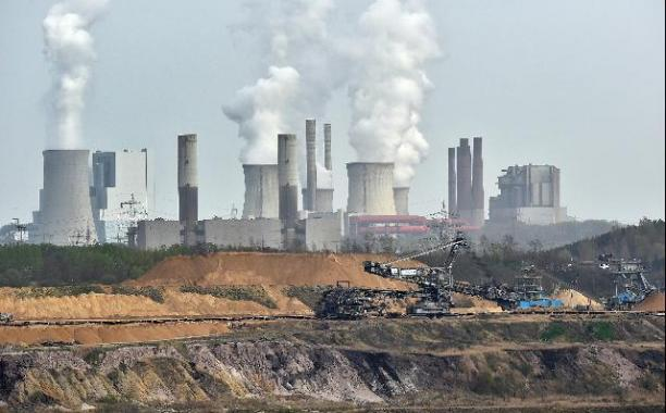 Giant machines dig for brown coal at an open-cast mining facility near the city of Grevenbroich in western Germany. (AP Photo/Martin Meissner, File)