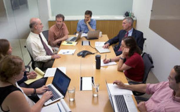 Two architects of the Natural Resources Defense Council's carbon-emissions proposal, David Doniger, third from left, and Daniel Lashof, facing him, participate in a meeting at the group's office in Washington.