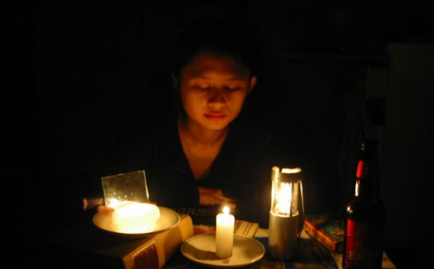 Power outage by candle light by Jeffrey Cuvilier (jaboney on Flickr)