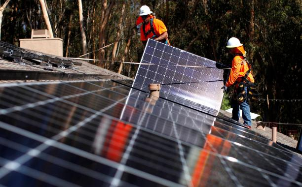 Installing solar panels on a home in Scripps Ranch, Calif. (Reuters photo: Mike Blake)
