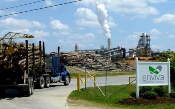 A logging truck loaded with freshly cut hardwoods enters the Enviva wood-pellet plant in Ahoskie, N.C. The Washington Post, Joby Warrick